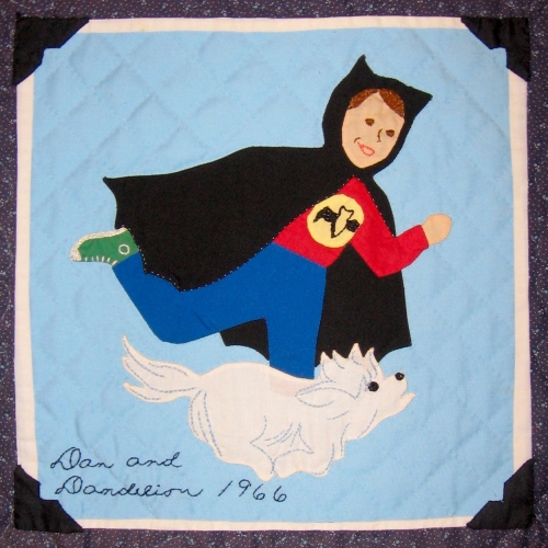 This is me when I was 5 years old. The image is a square from a family quilt my mother made. Each square depicted a scene involving at lest one of her 5 children.