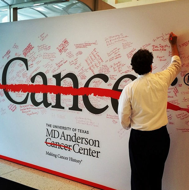 Signing the End Cancer Wall at MD Anderson Cancer Center.
